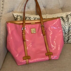 Pink vinyl Dooney and Bourke with red lining